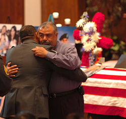Roy Velez is comforted by a fellow mourner at a memorial service for his son Andrew at the Church of the Nazarene in Lubbock.