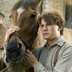 Horse and lad (Jeremy Irvine) head into battle.