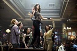 Idina Menzel (center) and Tracie Thoms (right) star in  the rock opera Rent.