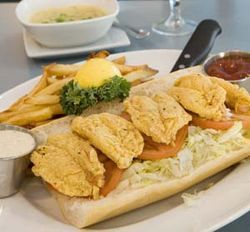 "Sophisticated dishes like ""crab poblano corn chowder"" share menu space with good old fried-shrimp po-boys."