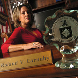 Roland Carnaby's widow, Susan, is suing the City of Houston over the shooting of her husband.