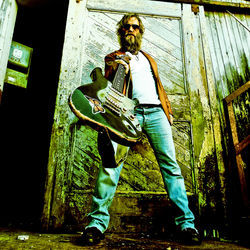 Anders Osborne backs New Orleans drum master Stanton Moore Saturday.