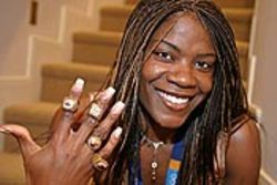 Ringin' 'em up: Swoopes shows off her championship  jewelry.