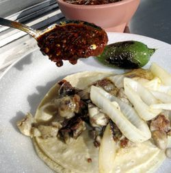 Taqueria Tacambaro&#039;s tacos de mollejas are a sublime way to start the day.