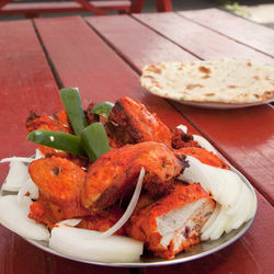 A half order of tandoori chicken is big enough to split between two people.