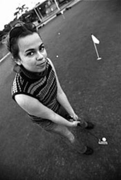 April Ayers plays with pink golf tees.