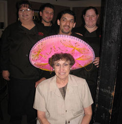 Irma Leal puts on the birthday sombrero to celebrate Leal's 51st anniversary.