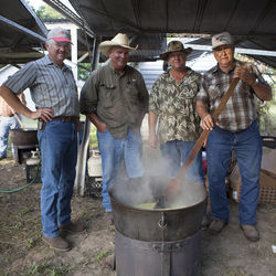 "The Grawunder boys make the barbecue ""gravy."" (From right:) James Grawunder has been cooking here for 58 years, his nephew Tom and sons Ray and James Jr. help out."
