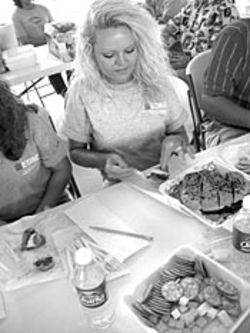 Burger judge Amanda Stewart samples the winner at  the Uncle Fletch's Hamburger Cook-off.