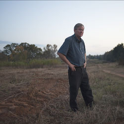 Property owner Michael Bishop ran surveyors off his land, but TransCanada eventually won the rights to a strip of his land in Nacogdoches County