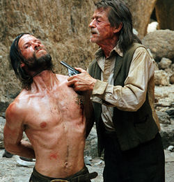 The Proposition stars Guy Pearce as a murderous outlaw and John Hurt as a bounty hunter.