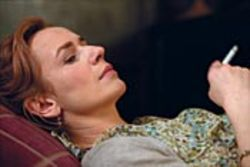 Anna (Sandrine Bonnaire) reclines on the wrong  couch in Intimate Strangers.