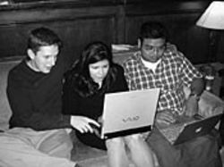 Computers come out even at social events. Here, Matt 