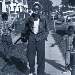 The King of Dowling Street: Sam &quot;Lightnin&#039;&quot; Hopkins striding through his Third Ward domain. McCormick rediscovered Hopkins in the late &#039;50s and intermittently managed his career later.