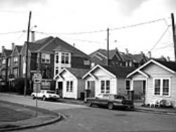 "The last of the ""little houses"" in the Fourth Ward are  crowded by new Perry town homes."