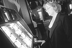 Brenda Plilar, whose nickname inspired Sassy's, checks the source of the bar's woes.