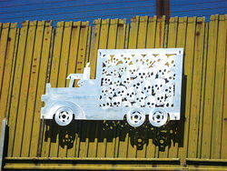 In this artwork, on the border fence in Nogales, Sonora, the skulls stuffed in the back of a
