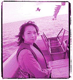 In an industry traditionally dominated by males, Thuy leads the shrimpers in the fight against more regulations.
