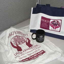 Private group homes hand out free T-shirts and tote bags at the state school.