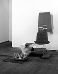 Construction materials dance with domestic items in  this 2003 work.
