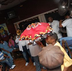 Second-liners dance the Monday blues away at Libra Lounge.
