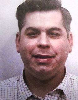 A jury decided  Dinesh Shah, pictured shortly after his arrest for beating Kaleta Johnson in 2002, should hand over $20.7 million in damages.