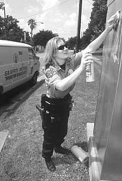 Officer D.M. Camp's job is to battle graffiti.