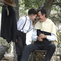 "Plainview (Daniel Day-Lewis) travels the West with his ""partner and son"" (Dillon Freasier)."