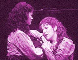 Holding on for dear life: Stephanie Novacek as Jo can't let go of her sister Meg (Joyce DiDonato).
