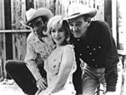 Montgomery Clift, Marilyn Monroe and Clark Gable  horse around in The Misfits. See Monday.