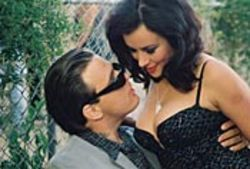 Damian Chapa and the boob-a-riffic Jennifer Tilly get  cozy in El Padrino. See Saturday.