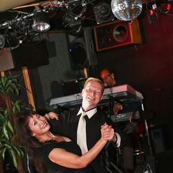 Lance Stewart has been cutting a rug at Caps Piano Bar for a quarter century.