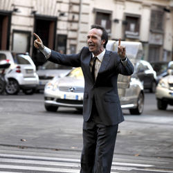 Roberto Benigni steps outside to discover he's famous for no reason.