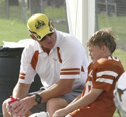 Longhorn coach Skip Cummins talks to his son, Max, after chewing him out for a foul.