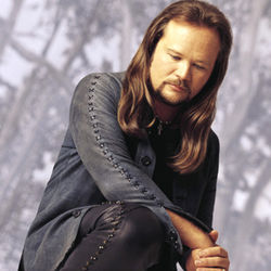 Travis Tritt wishes he had that quarter back.