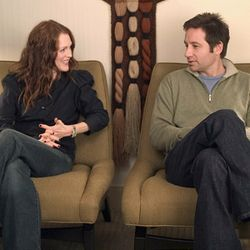Stock schmucks: Rebecca (Julianne Moore) and Tom (David Duchovny).