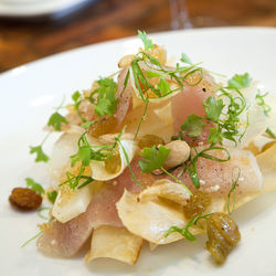 The machi cure features smoked baby yellowtail, dehydrated yuca, garlic brittle and Marcona almonds.