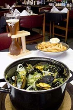 You can't go wrong with Cafe Montrose's mussels and  fries and a good Belgian beer.