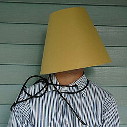 "Without a Face attempts to impress Channel 11's Lucy Noland with the ageless ""lampshade on the head"" gag."