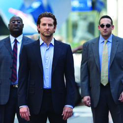 No-prescription-necessary superhero: Eddie (Bradley Cooper, center).