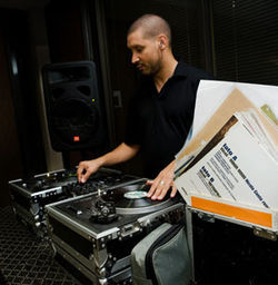 "DJ Sun, the General Patton of the decks, leads his twin Technics ""tanks"" into battle."