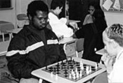If Scarborough hadn't moved the chess club to midday, Johnny Jones (left), playing chess with Kirk Runyon, says he never could have joined because he works after school.