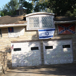Robert Searcy has had several run-ins with longtime Glenbrook Valley resident T.C. Burton, who displays multiple Confederate flags at his home.