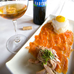 The cold  salmon is cured with Tabasco mash and served with a duck egg.