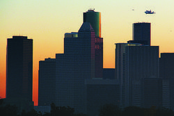 The shuttle makes one final pass over the Houston skyline before heading out of town for good.