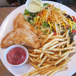 Amazon Grill's fries come with its burger as well as its empanadas and tacos.