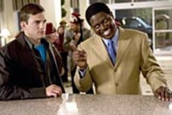 Are we being Punk'd? Ashton Kutcher (with  Bernie Mac) plays a role once filled by Sidney Poitier.
