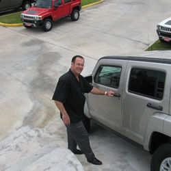 "Hummers are the anti-Prius, but at a dealership south of Houston, salesman Kenny Triola suggests, ""We could always put a Prius on top of a H2 and get through anything."""